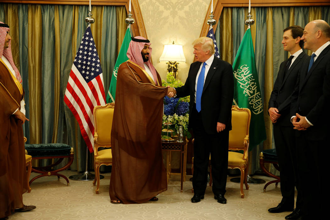 U.S. President Donald Trump meets with Saudi Arabia's Deputy Crown Prince and Minister of Defense Mohammed bin Salman (center L) at the Ritz Carlton Hotel in Riyadh, Saudi Arabia May 20, 2017. (Jo ...