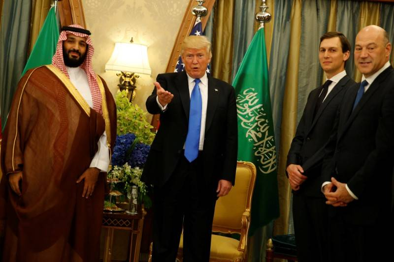 U.S. President Donald Trump, flanked by White House senior advisor Jared Kushner (2nd R) and chief economic advisor Gary Cohn (R), delivers remarks to reporters after meeting with Saudi Arabia's D ...