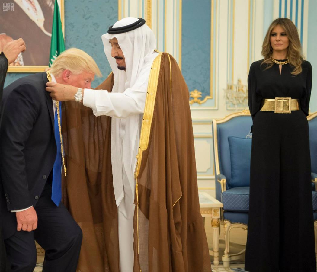 Saudi Arabia's King Salman bin Abdulaziz Al Saud presents U.S. President Donald Trump with the Collar of Abdulaziz Al Saud Medal as first lady Melania Trump watches, at the Royal Court in Riyadh,  ...