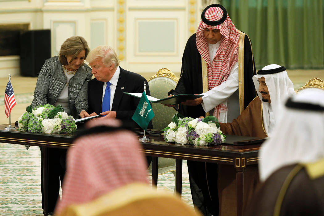 Saudi Arabia's King Salman bin Abdulaziz Al Saud (R) and U.S. President Donald Trump sign a joint security agreement at the Royal Court in Riyadh, Saudi Arabia May 20, 2017. (Jonathan Ernst/Reuters)