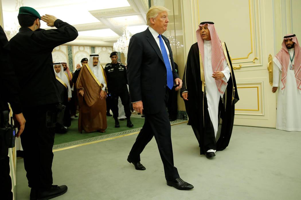 Saudi Arabia's King Salman bin Abdulaziz Al Saud (L, in brown) and U.S. President Donald Trump (C) arrive for their bilateral meeting at the Royal Court in Riyadh, Saudi Arabia May 20, 2017. (Jona ...
