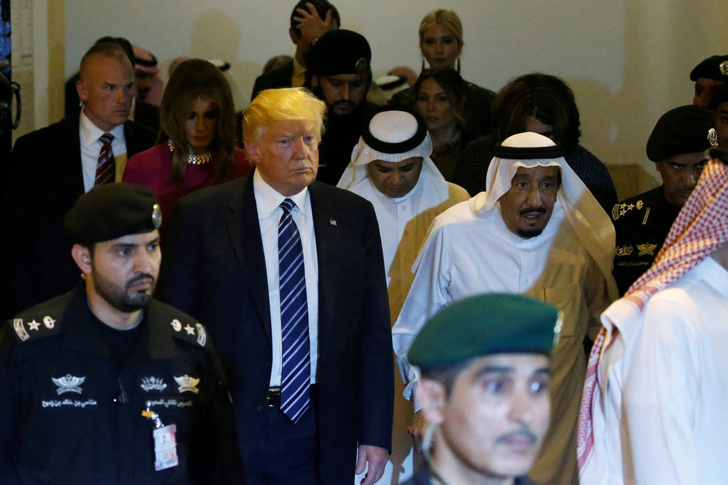 Saudi Arabia's King Salman bin Abdulaziz Al Saud (center R, in all white head-covering) gives U.S. President Donald Trump (center L) a tour during a welcome ceremony at Al Murabba Palace in Riyadh ...