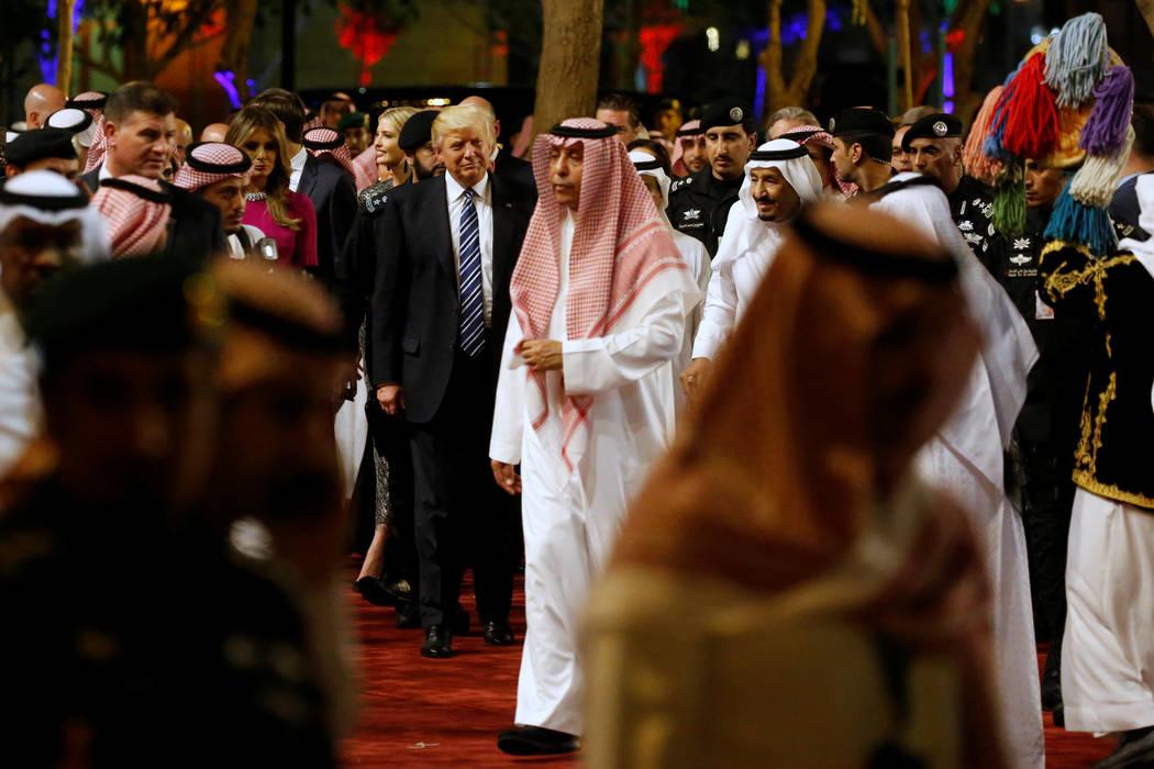 Saudi Arabia's King Salman bin Abdulaziz Al Saud (center R, in all white head-covering) welcomes U.S. President Donald Trump during a welcome ceremony at Al Murabba Palace in Riyadh, Saudi Arabia  ...
