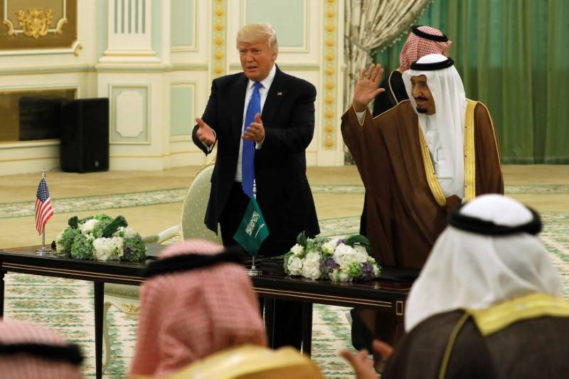Saudi Arabia's King Salman bin Abdulaziz Al Saud (R) and U.S. President Donald Trump (L) react to applause after signing a joint security agreement at the Royal Court in Riyadh, Saudi Arabia May 2 ...