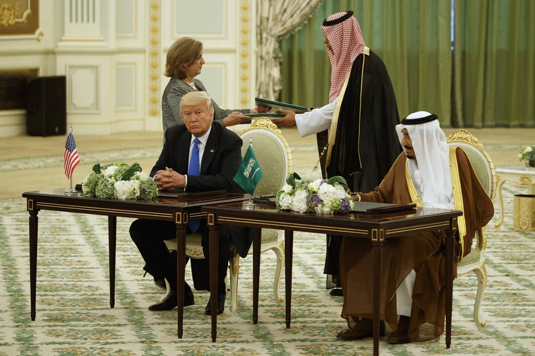 President Donald Trump and Saudi King Salam participate in a signing ceremony at the Royal Court Palace, Saturday, May 20, 2017, in Riyadh. (Evan Vucci/AP)