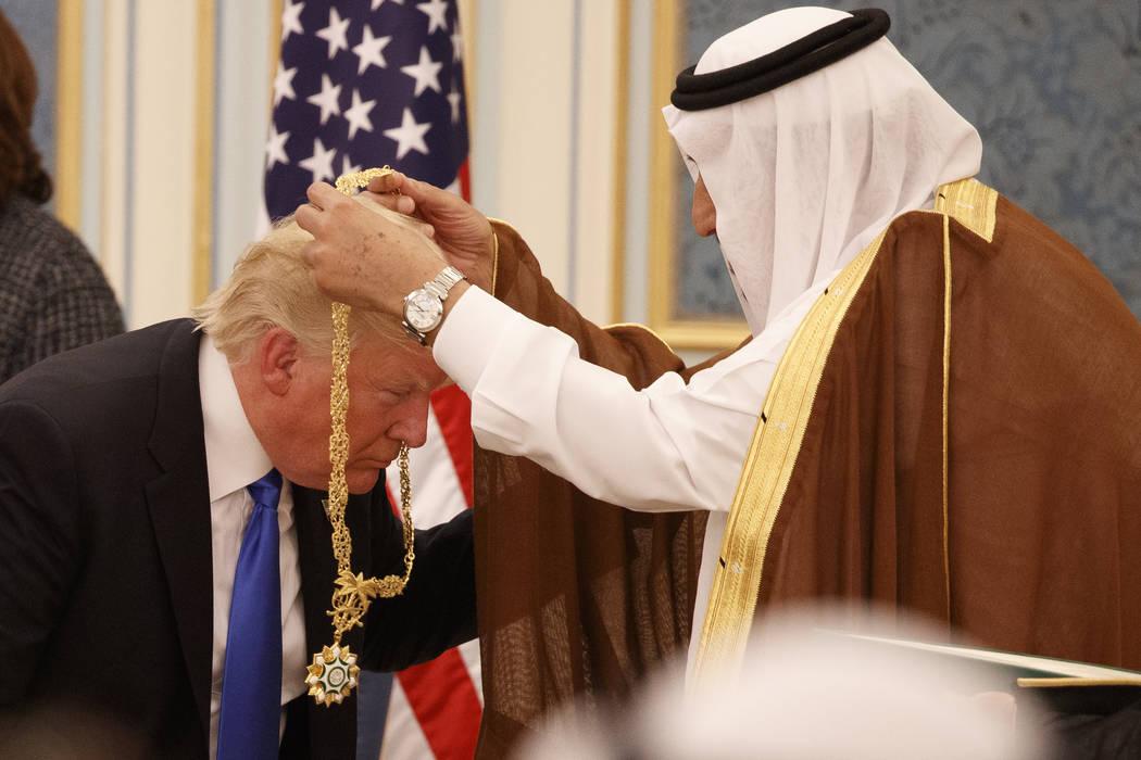 Saudi King Salman presents President Donald Trump with The Collar of Abdulaziz Al Saud Medal at the Royal Court Palace, Saturday, May 20, 2017, in Riyadh. (Evan Vucci/AP)