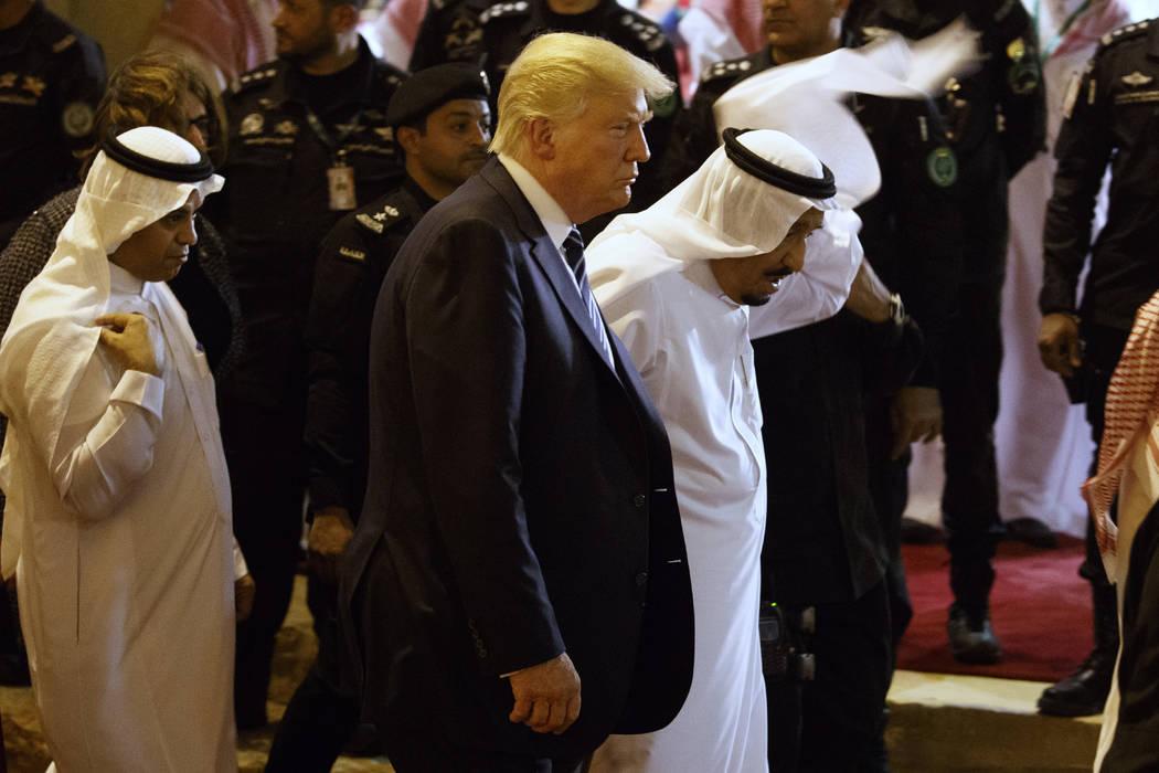 President Donald Trump walks with Saudi King Salman during a welcome ceremony at Murabba Palace, Saturday, May 20, 2017, in Riyadh. (Evan Vucci/AP)