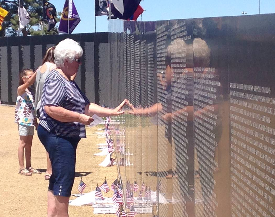 Aleta Daniels touches a replica of the Vietnam Veterans Memorial on Saturday, May 20, 2017, during the third-annual American Patriot Fest. Katelyn Newberg/Las Vegas Review-Journal
