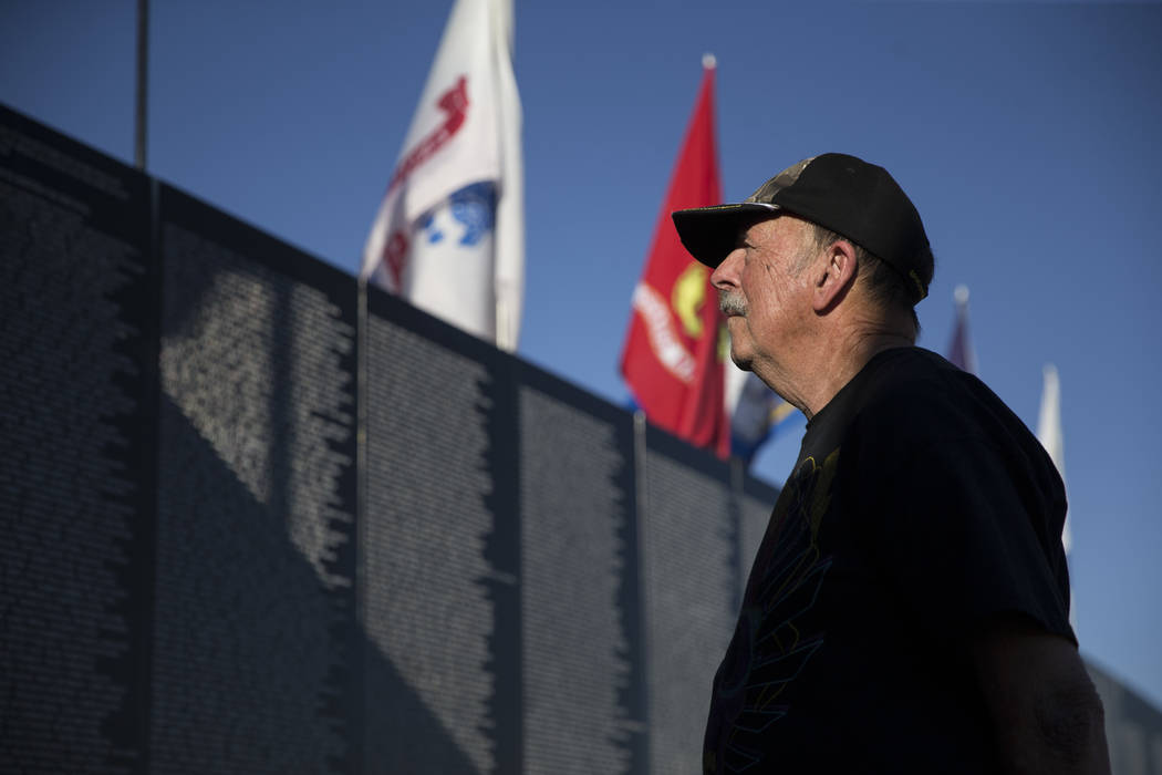 U.S. Navy veteran George Schick visits the replica Vietnam Veterans Memorial Wall hosted by the American Veterans Traveling Tribute at Craig Ranch Park on Friday, May 19, 2017 in North Las Vegas.  ...