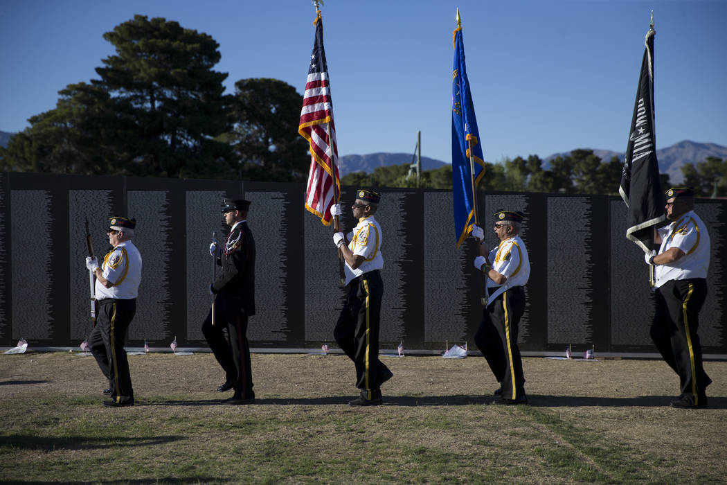A local multi-agency honor guard during the opening ceremony for the replica of Vietnam Veterans Memorial Wall hosted by the American Veterans Traveling Tribute at Craig Ranch Park on Friday, May  ...