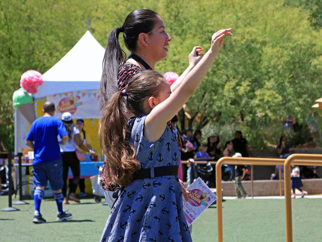 Isla Johnson, 6, and Maria Silva dance to one of the live performances during the Ice Cream Festival at the Springs Preserve, Saturday, May 20, 2017. Gabriella Benavidez Las Vegas Review-Journal @ ...