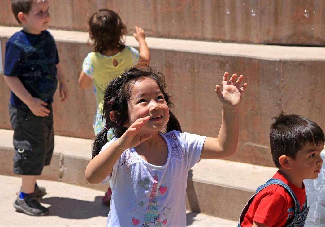 Neah Manmalai, 3, center, jumps to pop a bubble during the Ice Cream Festival at the Springs Preserve, Saturday, May 20, 2017. Gabriella Benavidez Las Vegas Review-Journal @latina_ish