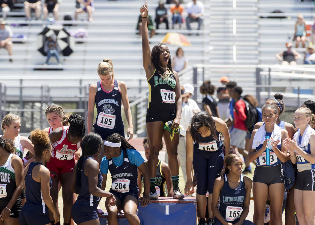 Girls 4x100-meter relay runners fill the podium for their medals during the NIAA 4A State Track & Field Championships at Foothill High School on Saturday, May 20, 2017 in Henderson. Rancho pla ...