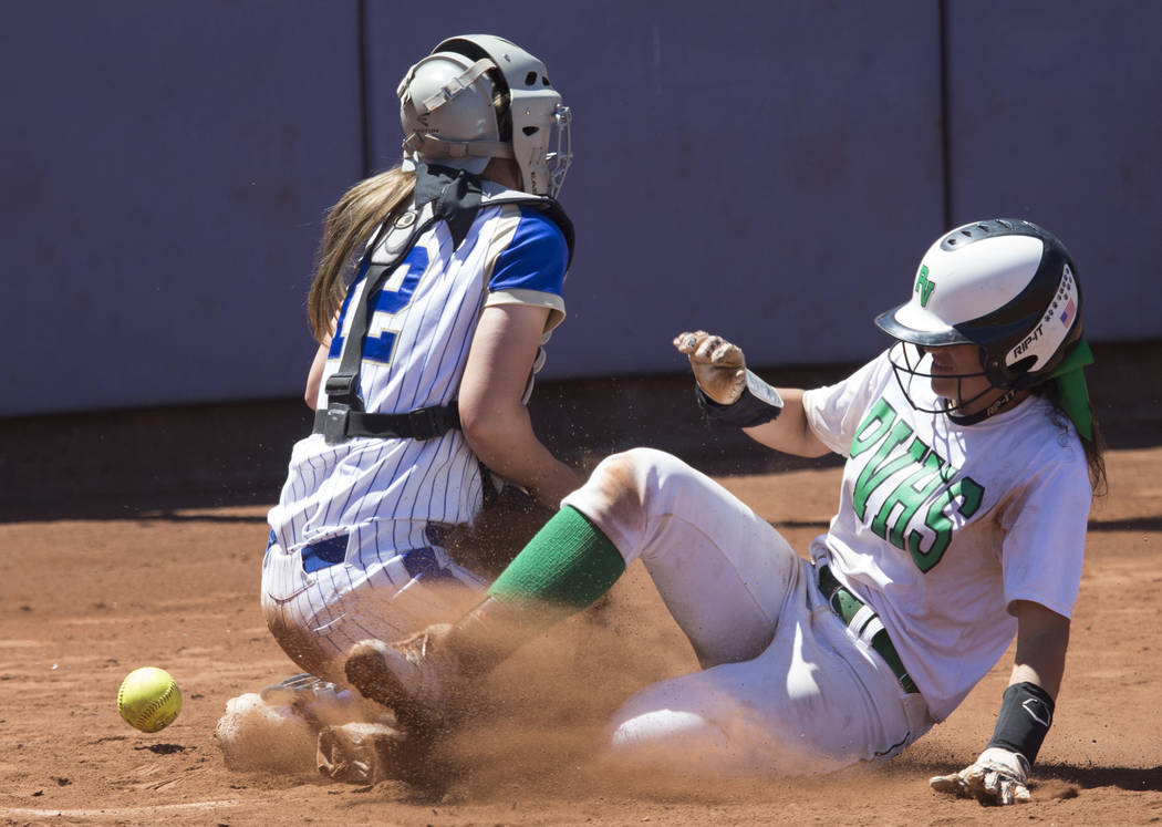 Palo Verde's Cara Beatty (5) slides home for a run against Reed's Jilian Kygar (12) in the Nevada Class 4A state softball final on Saturday, May 20, 2017 in Las Vegas. Palo Verde won 9-3. Erik Ver ...