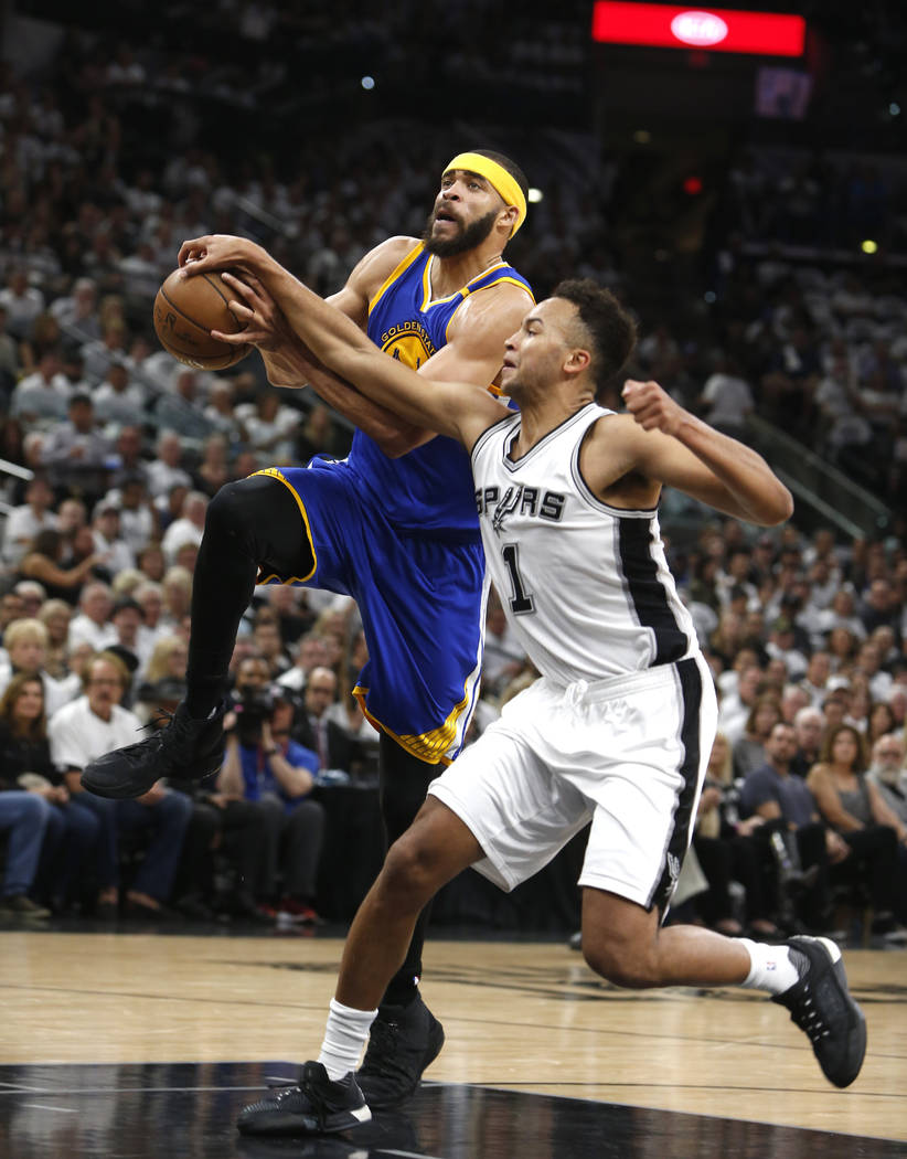 San Antonio Spurs guard Kyle Anderson(1) knocks the ball from a driving Golden State Warriors center JaVale McGee (1) during the first half of Game 3 of of the Western Conference finals on Saturda ...