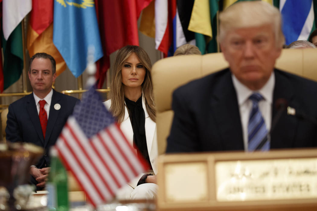 White House chief of staff Reince Priebus, left, and first Lady Melania Trump wait for President Donald Trump to deliver a speech to the Arab Islamic American Summit, at the King Abdulaziz Confere ...
