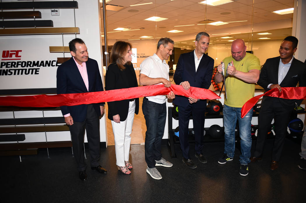 Executives from Hospital For Special Surgery and the UFC held a ribbon-cutting ceremony in front of the HSS physical therapy suite inside the UFC Performance Institute during a grand opening party ...