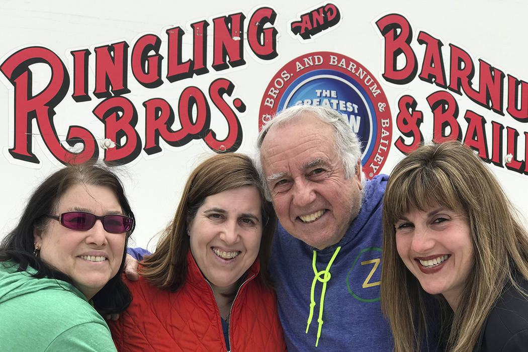 Gene Goldstein, center right, and his family stop for a photo outside the Nassau Veteran's Memorial Coliseum in Uniondale, N.Y., which is hosting the final performances of the Ringling Brothers an ...
