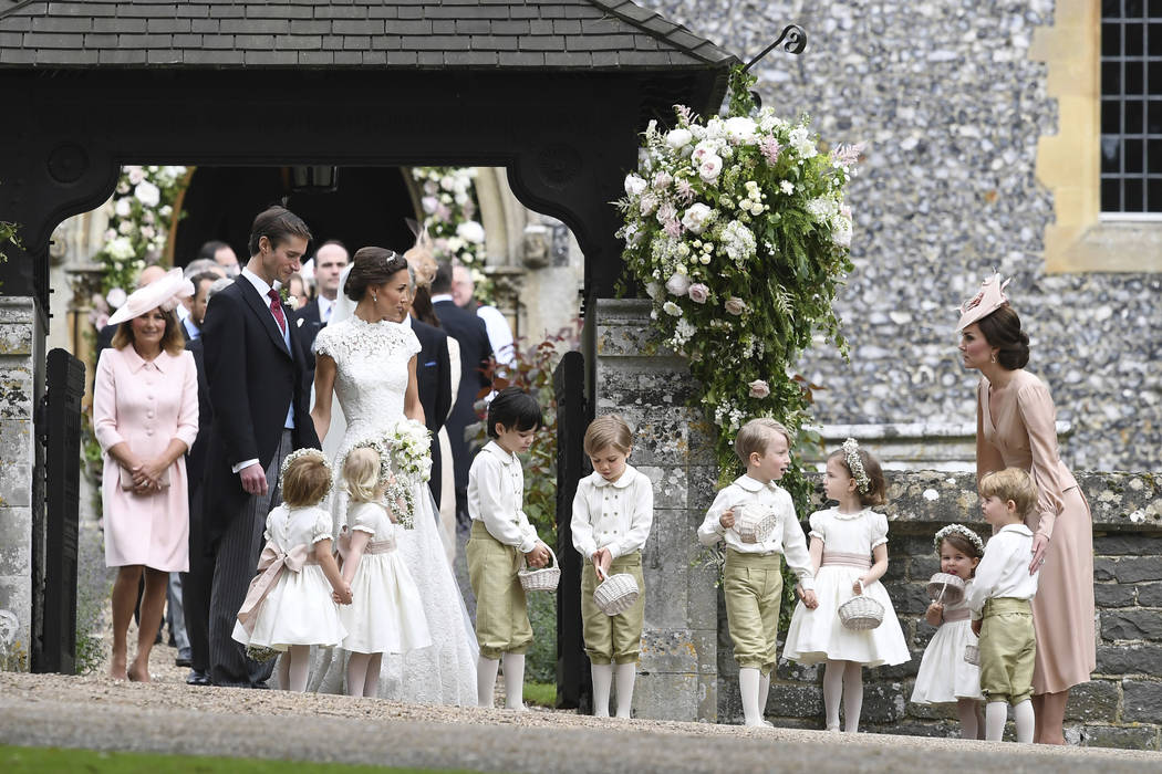 Britain's Kate, the Duchess of Cambridge, right, stands with her children Prince George and Princess Charlotte, following the wedding ceremony of her sister Pippa Middleton and James Matthews, at  ...