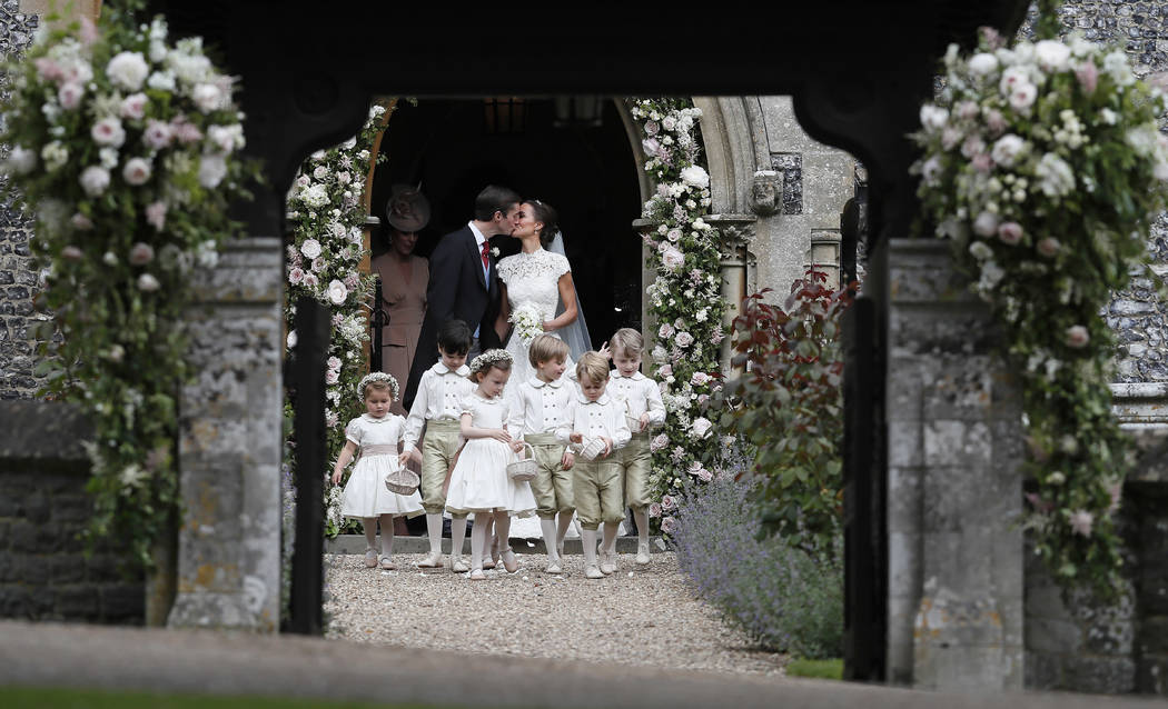 Pippa Middleton and James Matthews kiss after their wedding at St Mark's Church in Englefield, England Saturday, May 20, 2017. Middleton, the sister of Kate, Duchess of Cambridge married hedge fun ...