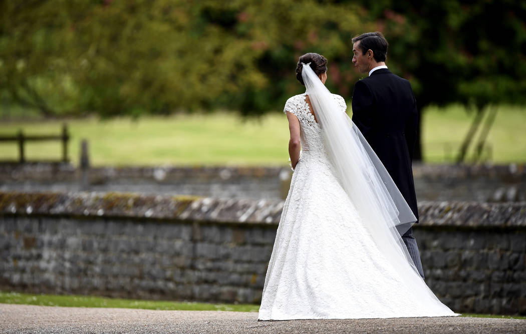 Pippa Middleton, second right and James Matthews walk, after their wedding ceremony, at St Mark's Church in Englefield, England Saturday, May 20, 2017. Middleton, the sister of Kate, Duchess of Ca ...