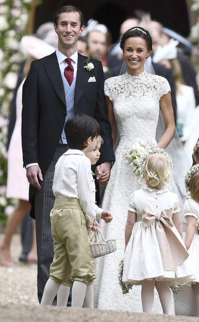 Pippa Middleton, right and James Matthews smile after their wedding at St Mark's Church in Englefield, England, Saturday, May 20, 2017. Middleton, the sister of Kate, Duchess of Cambridge married  ...