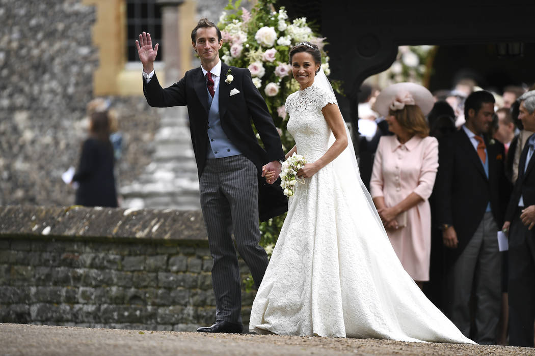 Pippa Middleton, centre right, walks with James Matthews after their wedding at St Mark's Church in Englefield, England Saturday, May 20, 2017. Middleton, the sister of Kate, Duchess of Cambridge  ...