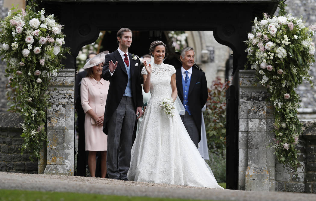 Pippa Middleton and James Matthews smile after their wedding at St Mark's Church in Englefield, England Saturday, May 20, 2017. Middleton, the sister of Kate, Duchess of Cambridge married hedge fu ...