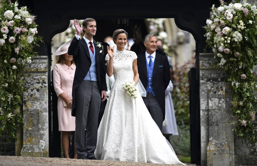 Pippa Middleton, centre and James Matthews gesture after their wedding at St Mark's Church in Englefield, England Saturday, May 20, 2017. Middleton, the sister of Kate, Duchess of Cambridge marrie ...