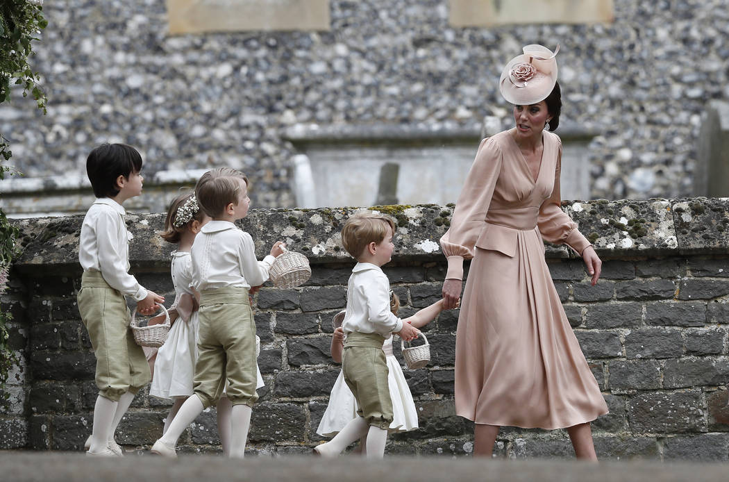 Kate, Duchess of Cambridge, right, walks with the flower boys and girls after the wedding of Pippa Middleton and James Matthews at St Mark's Church in Englefield, England Saturday, May 20, 2017. M ...