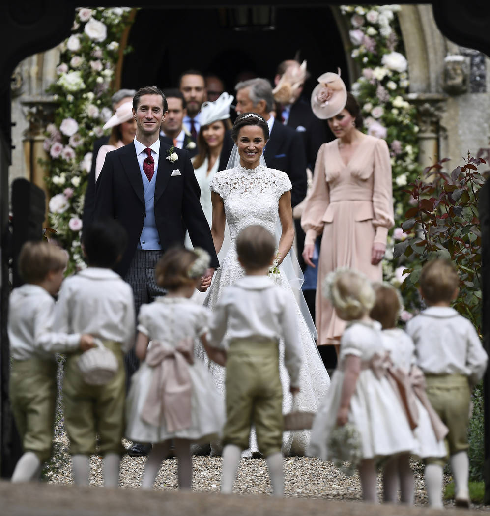 Pippa Middleton, centre and James Matthews smile, after their wedding at St Mark's Church in Englefield, England Saturday, May 20, 2017. Middleton, the sister of Kate, Duchess of Cambridge married ...