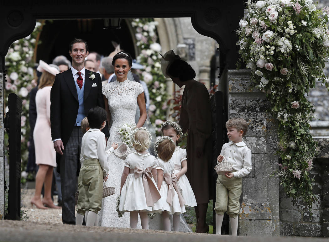Pippa Middleton and James Matthews smile after their wedding at St Mark's Church in Englefield, England Saturday, May 20, 2017. (AP Photo/Kirsty Wigglesworth, Pool)