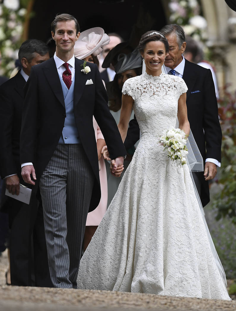 Pippa Middleton, right and James Matthews walk, after their wedding ceremony, at St Mark's Church in Englefield, England Saturday, May 20, 2017. Middleton, the sister of Kate, Duchess of Cambridge ...