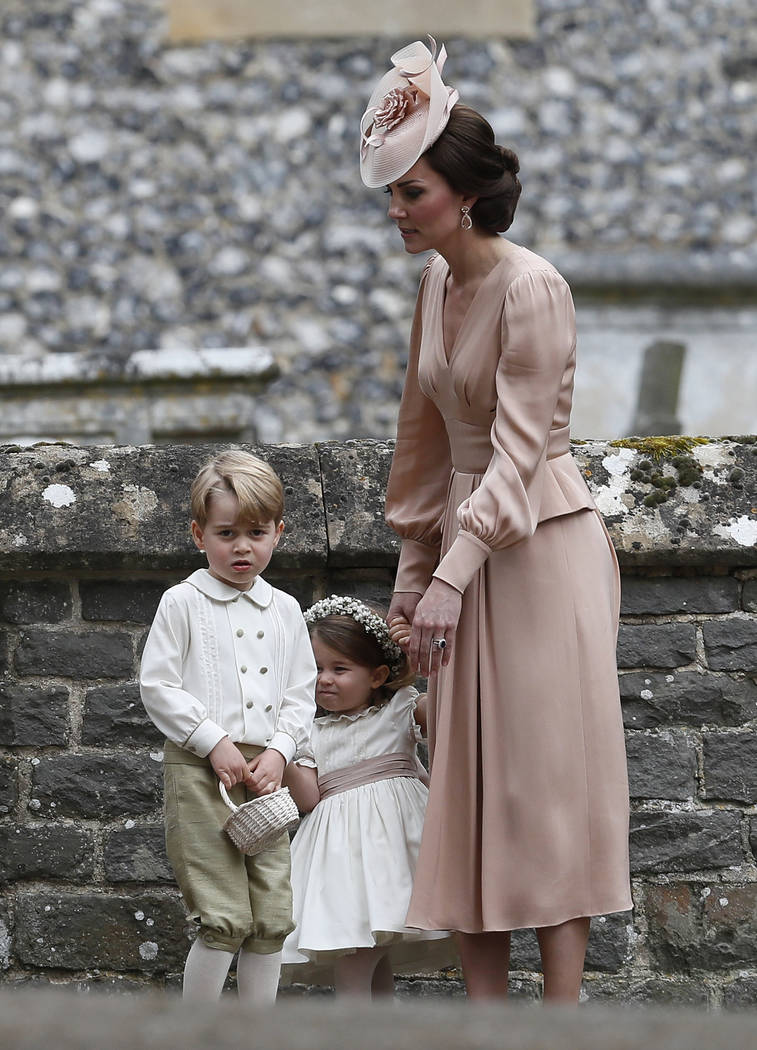 Kate, Duchess of Cambridge, right, stands with Princess Charlotte and Prince George, who were flower boys and girls at the wedding of Pippa Middleton and James Matthews at St Mark's Church in Engl ...