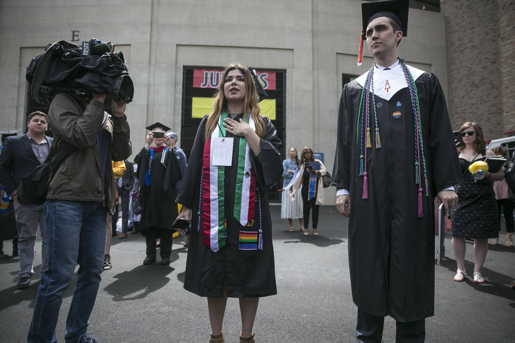 Ixtlaly Estrada makes remarks after Notre Dame students walked out of the commencement ceremony in opposition opposed to the Trump administration's policies, as Vice President Mike Pence was intro ...