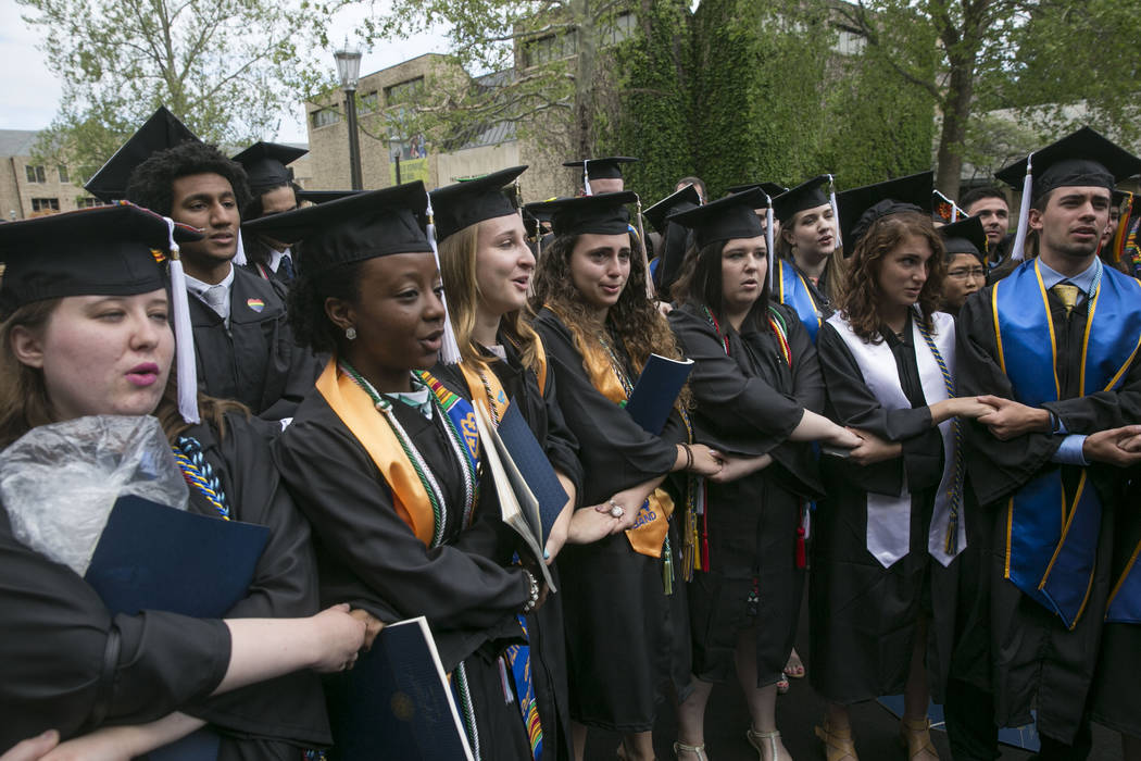 Notre Dame students walk out of the commencement ceremony as Vice President Mike Pence is introduced at Notre Dame Stadium on Sunday, May 21, 2017, in South Bend, Ind. (Santiago Flores/South Bend  ...