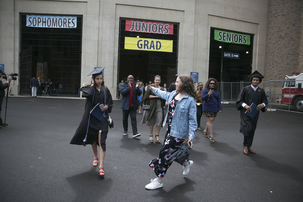 Notre Dame students walk out of the commencement ceremony in opposition opposed to the Trump administration's policies as Vice President Mike Pence is introduced at Notre Dame Stadium on Sunday, M ...