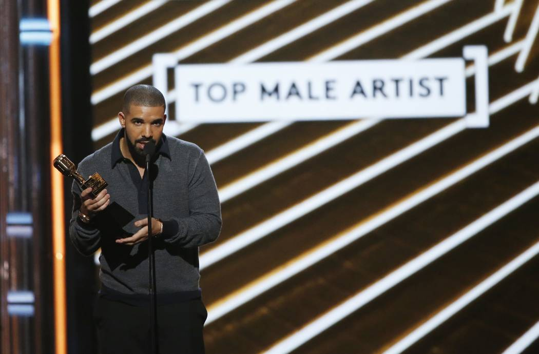 Drake accepts the Top Male Artist award in Las Vegas. (REUTERS/Mario Anzuoni)