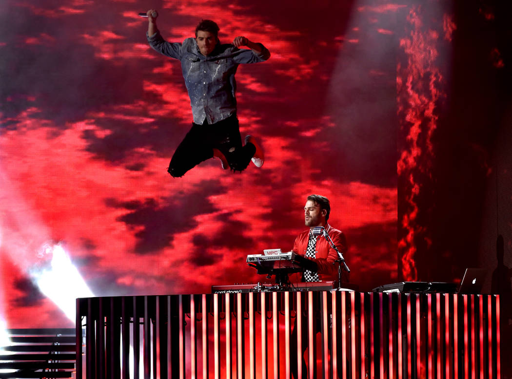 "Andrew Taggart, left, and Alex Pall, right of The Chainsmokers, perform ""Young"" at the Billboard Music Awards at the T-Mobile Arena on Sunday, May 21, 2017, in Las Vegas. (Photo  ..."