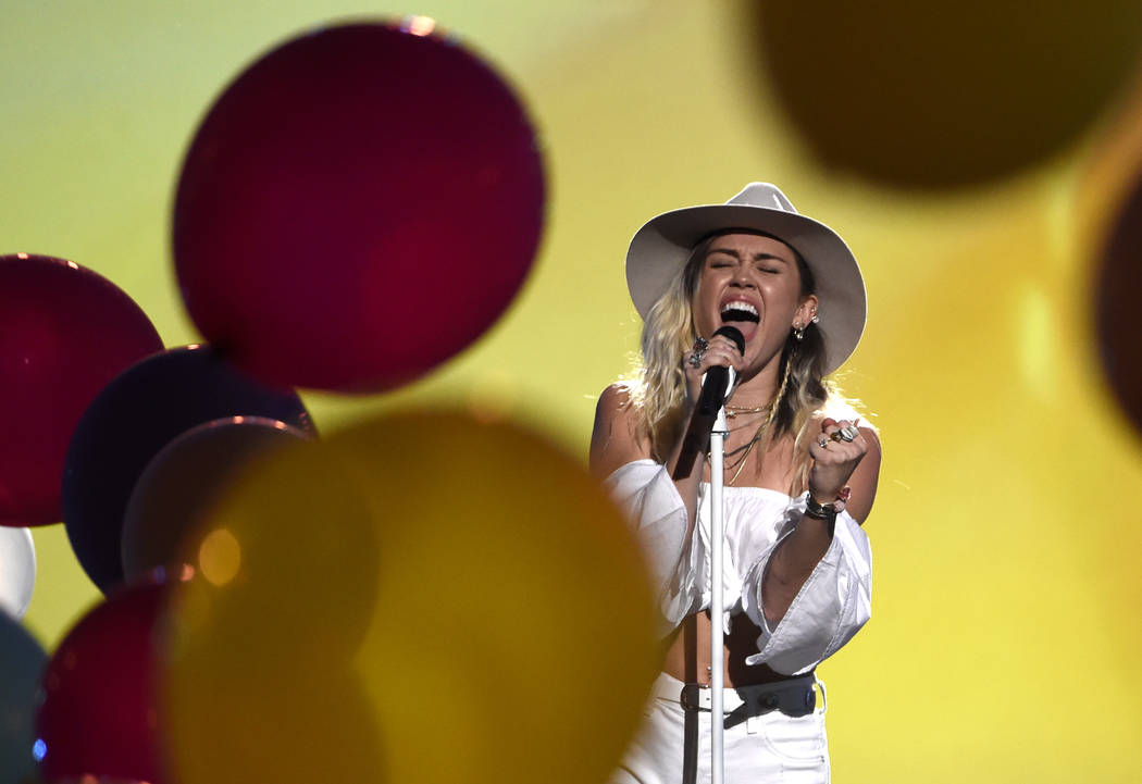 "Miley Cyrus performs ""Malibu"" at the Billboard Music Awards at the T-Mobile Arena on Sunday, May 21, 2017, in Las Vegas. (Photo by Chris Pizzello/Invision/AP)"