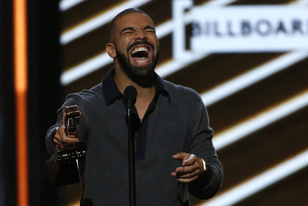 Drake accepts the award for Top Billboard 200 Album. REUTERS/Mario Anzuoni