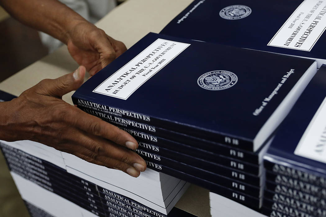 "A GPO worker stacks copies of ""Analytical Perspectives Budget of the U.S. Government Fiscal Year 2018"" onto a pallet at the U.S. Government Publishing Office's (GPO) plant in Washington. (AP Photo ..."