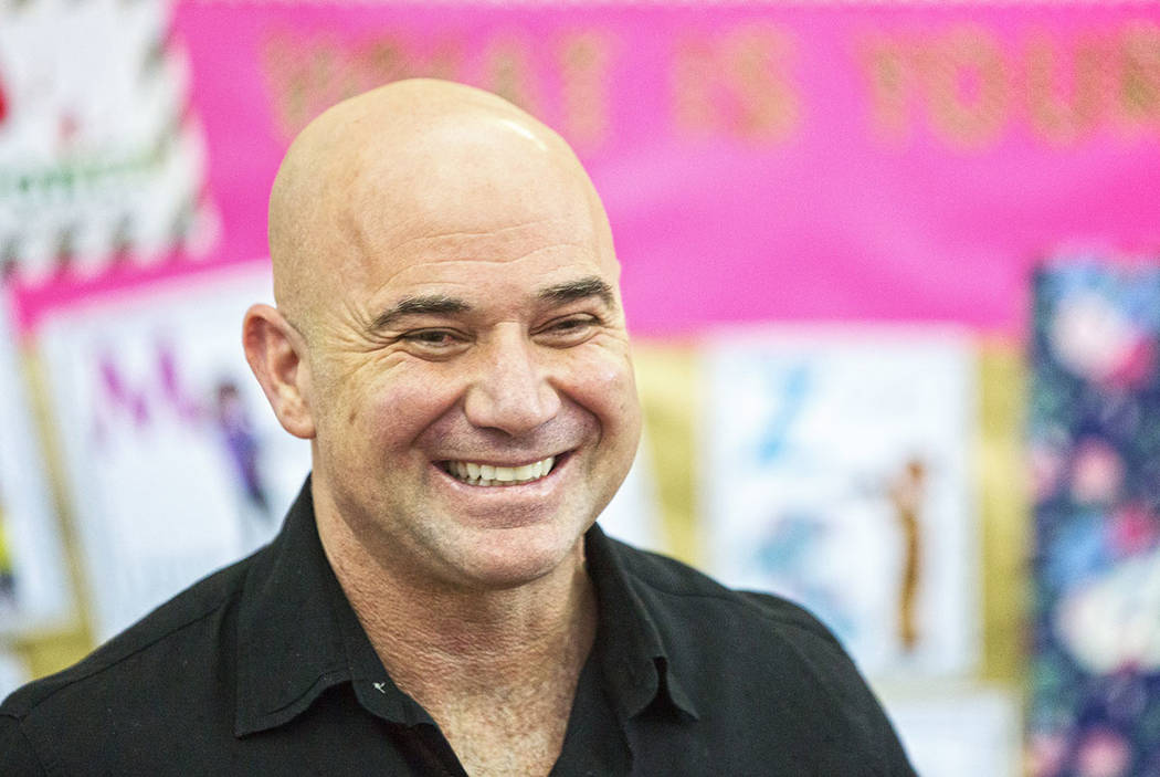 Andre Agassi shares a laugh during an event at Andre Agassi Preparatory Academy in February.  (Benjamin Hager/Las Vegas Review-Journal)
