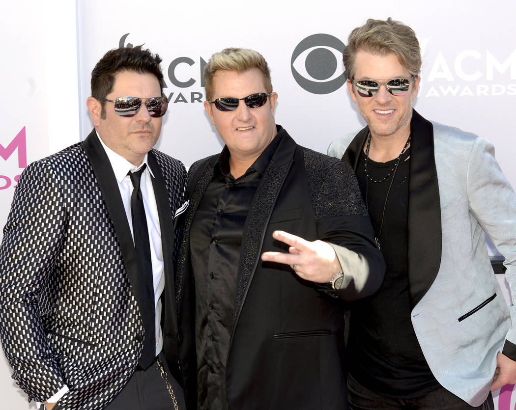 Jay DeMarcus, Gary LeVox and Joe Don Rooney of Rascal Flatts walk The Academy of Country Music Awards red carpet at T-Mobile Arena on Sunday, April 2, 2017, in Las Vegas. (Glenn Pinkerton/ Las Veg ...