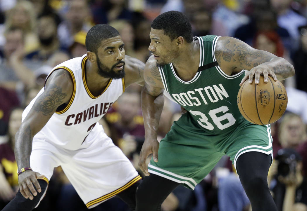Boston Celtics' Marcus Smart (36) looks to drive on Cleveland Cavaliers' Kyrie Irving (2) during the second half of Game 3 of the NBA basketball Eastern Conference finals, Sunday, May 21, 2017, in ...