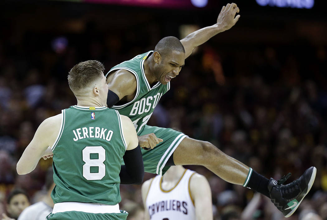 Boston Celtics' Jonas Jerebko (8), from Sweden, celebrates with Al Horford (42), from Dominican Republic, during the second half of Game 3 of the NBA basketball Eastern Conference finals, Sunday,  ...
