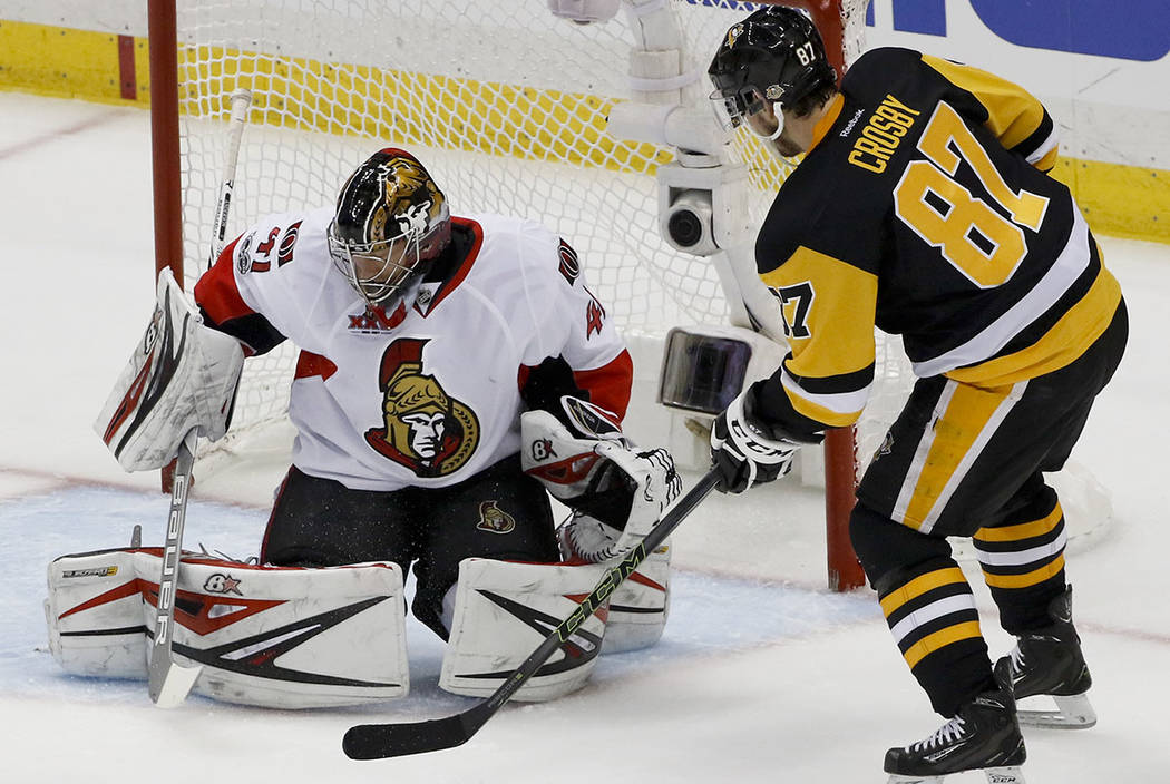 Pittsburgh Penguins' Sidney Crosby (87) scores on Ottawa Senators goalie Craig Anderson (41) during the first period of Game 5 in the NHL hockey Stanley Cup Eastern Conference finals, Sunday, May  ...