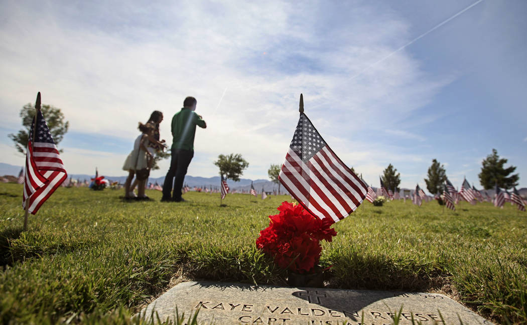 People walk through the Southern Nevada Veterans Memorial Cemetery following a Memorial Day ceremony in Boulder City on Monday, May 29, 2017. Chase Stevens Las Vegas Review-Journal @csstevensphoto
