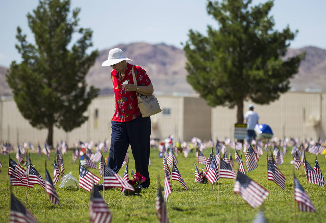 Rita Hickey walks through the Southern Nevada Veterans Memorial Cemetery after visiting the grave of her husband, Dan, following a Memorial Day ceremony in Boulder City on Monday, May 29, 2017. Ch ...