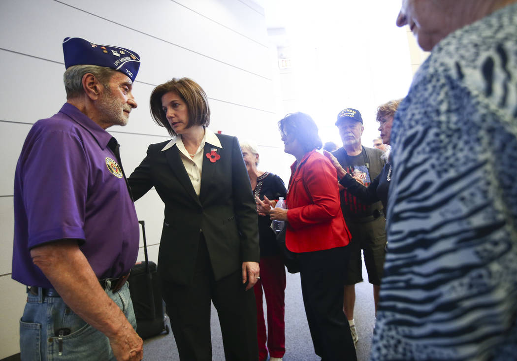 U.S. Sen. Catherine Cortez Masto, second from left, visits with veteran Gunny Steve during a Memorial Day ceremony at the Southern Nevada Veterans Memorial Cemetery in Boulder City on Monday, May  ...